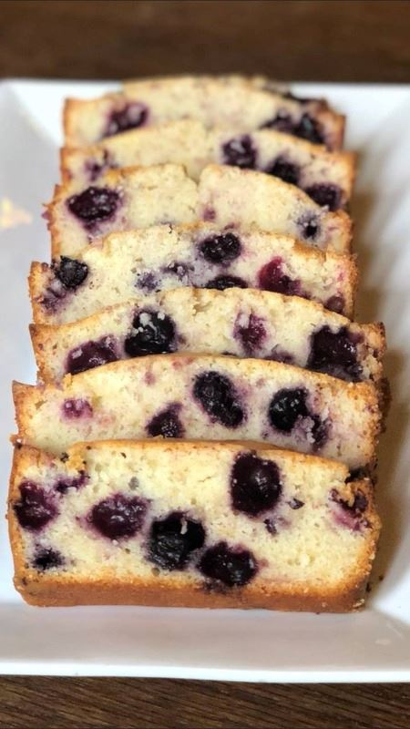 slices of blueberry pound cake on a white plate.