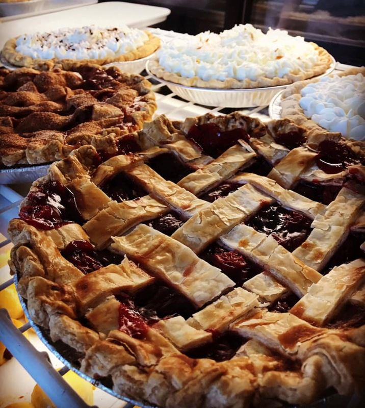 Vela farm pie case with 6 various pies. Cherry, coconut cream, chocolate swiss, apple. etc.