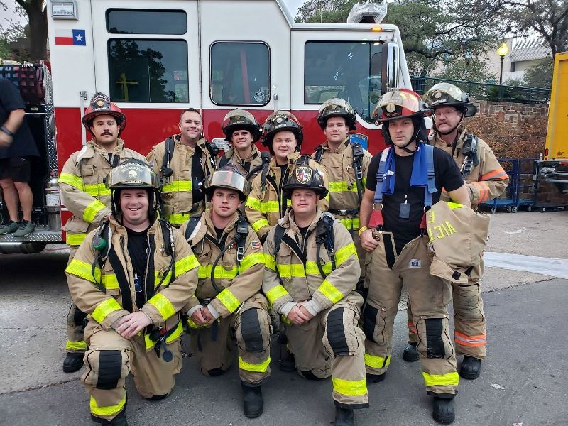 Members of the Victoria Fire Department pose for a photo