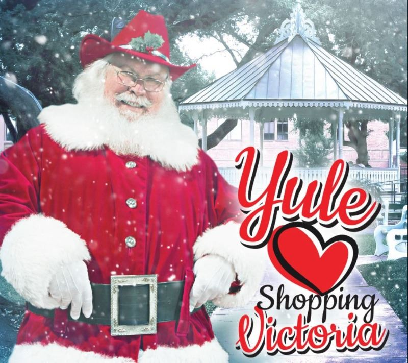 "Santa wearing a red cowboy hat at DeLeon Plaza. Text reads, ""Yule Heart Shopping Victoria."""
